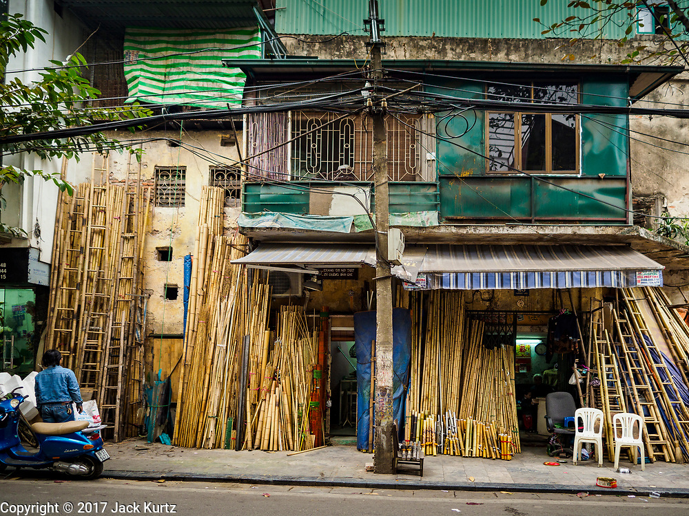 """24 DECEMBER 2017 - HANOI, VIETNAM: A shop selling bamboo in the old quarter of Hanoi. The old quarter is the heart of Hanoi, with narrow streets and lots of small shops but it's being """"gentrified"""" because of tourism and some of the shops are being turned into hotels and cafes for tourists and wealthy Vietnamese.           PHOTO BY JACK KURTZ"""