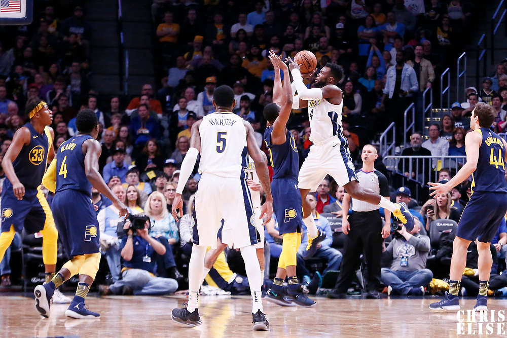 03 April 2018: Denver Nuggets forward Paul Millsap (4) takes a jump shot over Denver Nuggets forward Wilson Chandler (21) during the Denver Nuggets 107-104 victory over the Indiana Pacers, at the Pepsi Center, Denver, Colorado, USA.