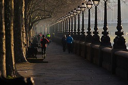 London, February 24th 2016. Runners and commuters make their way along Cheyne Walk in Chelsea as the sun rises on a chilly but clear morning in London. &copy;Paul Davey<br /> FOR LICENCING CONTACT: Paul Davey +44 (0) 7966 016 296 paul@pauldaveycreative.co.uk