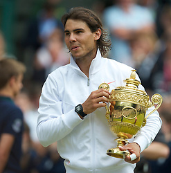 LONDON, ENGLAND - Sunday, July 4th, 2010: Rafael Nadal (ESP) celebrates with the trophy after winning the Gentlemen's Singles Final match 6-3, 7-5, 6-4 on day thirteen of the Wimbledon Lawn Tennis Championships at the All England Lawn Tennis and Croquet Club. (Pic by David Rawcliffe/Propaganda)