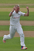 Luke Wood celebrates the wicket of Liam Dawson (not shown) during the Specsavers County Champ Div 1 match between Nottinghamshire County Cricket Club and Hampshire County Cricket Club at Trent Bridge, West Bridgford, United Kingdom on 13 August 2016. Photo by Simon Trafford.