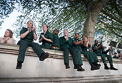 © Licensed to London News Pictures. 23/04/2020. London, UK. Paramedics clap and cheer at 8pm for the weekly Clap for Carers celebration outside St Thomas' Hospital in central London. Lockdown continues throughout the UK in an attempt to stop the spread of the coronavirus Covid-19 virus. Photo credit: Peter Macdiarmid/LNP
