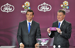 (L) ANDRIY SCHEVCHENKO AND (R) OLEG BLOCHIN (BOTH UKRAINE) SHOW THE TICKET OF GREECE DURING THE EUFA EURO 2012 QUALIFYING DRAW IN PALACE SCIENCE AND CULTURE IN WARSAW, POLAND..THE 2012 EUROPEAN SOCCER CHAMPIONSHIP WILL BE HOSTED BY POLAND AND UKRAINE...WARSAW, POLAND , FEBRUARY 07, 2010..( PHOTO BY ADAM NURKIEWICZ / MEDIASPORT / SPORTIDA.COM ).