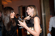 CLAUDIA WINKLEMAN; NATALIE MASSENET, Harper's Bazaar Women Of the Year Awards 2011. Claridges. Brook St. London. 8 November 2011. <br /> <br />  , -DO NOT ARCHIVE-© Copyright Photograph by Dafydd Jones. 248 Clapham Rd. London SW9 0PZ. Tel 0207 820 0771. www.dafjones.com.
