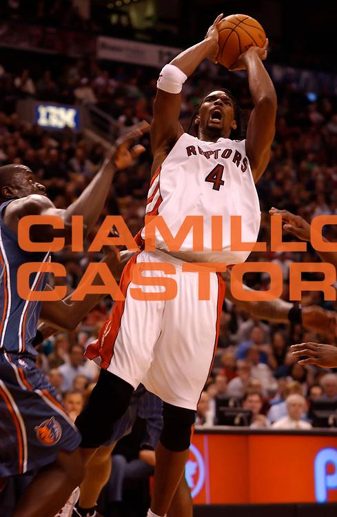 DESCRIZIONE : Toronto NBA 2009-2010 Toronto Raptors Charlotte Bobcats<br /> GIOCATORE : Chris Bosh<br /> SQUADRA : Toronto Raptors<br /> EVENTO : Campionato NBA 2009-2010 <br /> GARA : Toronto Raptors  Charlotte Bobcats<br /> DATA : 30/12/2009<br /> CATEGORIA :<br /> SPORT : Pallacanestro <br /> AUTORE : Agenzia Ciamillo-Castoria/V.Keslassy<br /> Galleria : NBA 2009-2010<br /> Fotonotizia : Toronto NBA 2009-2010 Toronto Raptors  Charlotte Bobcats<br /> Predefinita :