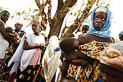 Women wait to have their children vaccinated in the village of Banankoro, Mali on Saturday August 28, 2010.