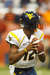 Oct 21, 2011; Syracuse NY, USA;  West Virginia Mountaineers quarterback Geno Smith (12) stands in the pocket against the Syracuse Orange during the fourth quarter at the Carrier Dome.  Syracuse defeated West Virginia 49-23. Mandatory Credit: Jason O. Watson-US PRESSWIRE