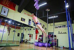 September 10, 2017 - Chengdu, Chengdu, China - Chengdu, CHINA-10th September 2017: (EDITORIAL USE ONLY. CHINA OUT)..Zhang Xida, a 69-year-old man, teaches a girl pole dance in Chengdu, southwest China's Sichuan Province, September 10th, 2017. Zhang started to learn pole dance in 2014. (Credit Image: © SIPA Asia via ZUMA Wire)
