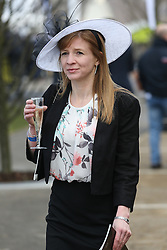 © Licensed to London News Pictures. 09/04/2016. Liverpool, UK. An elegant looking woman enjoys a drink on Grand National day of the Grand National 2016 at Aintree Racecourse near Liverpool. The race, which was first run in 1839, is the most valuable jump race in Europe. Photo credit : Ian Hinchliffe/LNP