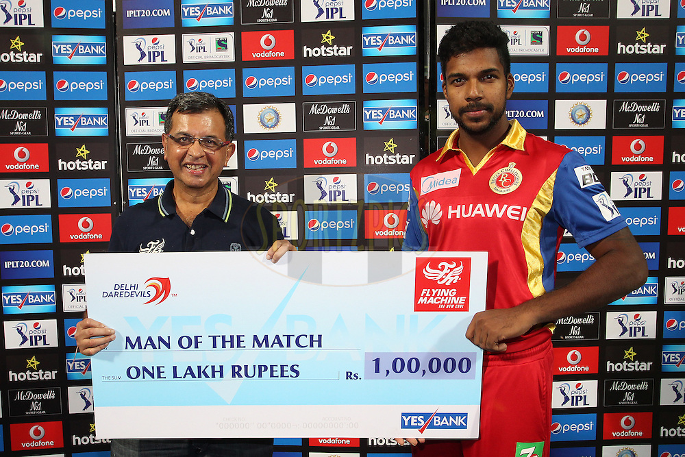 Man of the Match Varun Aaron of the Royal Challengers Bangalore during match 26 of the Pepsi IPL 2015 (Indian Premier League) between The Delhi Daredevils and The Royal Challengers Bangalore held at the Ferozeshah Kotla stadium in Delhi, India on the 26th April 2015.<br /> <br /> Photo by:  Shaun Roy / SPORTZPICS / IPL