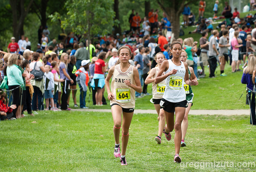 Coming off Spectator Hill (L to R: Davis freshman Ally Geisler and Highland-Pocatello senior DiSeanna Kilgoreof) on loop one during the Bob Firman Invitational D1 race (schools 800+) at Eagle Island State Park in Eagle, Idaho on September 21, 2013.<br /> <br /> Geisler finished fourth (19:52.72) and Kilgore fifth (19:54.44) in the 193 race field.