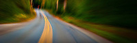 an abstract image of a curve in the road in the forest panorama