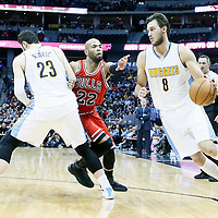 22 November 2016: Denver Nuggets forward Danilo Gallinari (8) drives past Chicago Bulls forward Taj Gibson (22) on a screen set by Denver Nuggets center Jusuf Nurkic (23) during the Denver Nuggets 110-107 victory over the Chicago Bulls, at the Pepsi Center, Denver, Colorado, USA.
