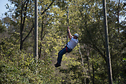 Bill Stec ziplines at The Ridges on Parents Weekend. Photo by Hannah Ruhoff