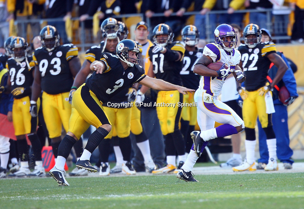 Minnesota Vikings kick returner Percy Harvin (12) gets chased by Pittsburgh Steelers kicker Jeff Reed (3) as he returns a kickoff 88 yards for a fourth quarter touchdown that cuts the Steelers lead to 20-17 during the NFL football game, October 25, 2009 in Pittsburgh, Pennsylvania. The Steelers won the game 27-17. (©Paul Anthony Spinelli)