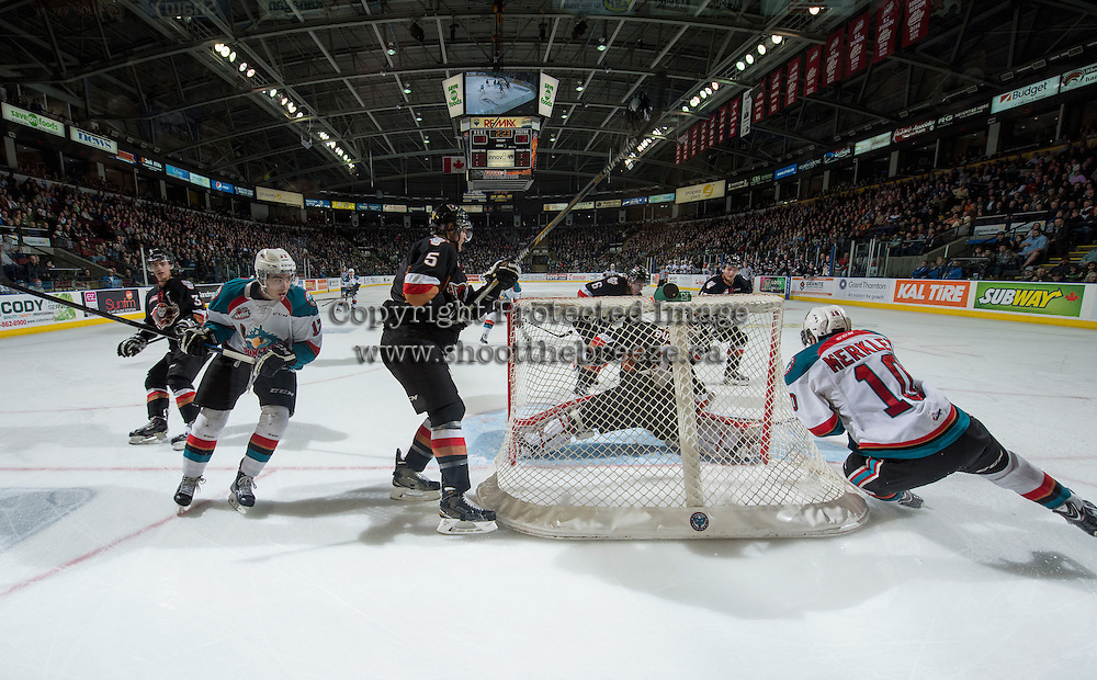 KELOWNA, CANADA - FEBRUARY 28: Brendan Burke #1 of Calgary Hitmen defends the net against Nick Merkley #10 and Rodney Southam #17 of Kelowna Rockets as they try to score a late period goal on February 28, 2015 at Prospera Place in Kelowna, British Columbia, Canada.  (Photo by Marissa Baecker/Shoot the Breeze)  *** Local Caption *** Nick Merkley; Rodney Southam;