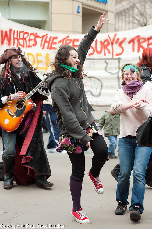 demonstrators play music and dance outside Sheffield Town Hall close Sheffield City Hall where the Liberal Democrats are holding their Party conference Conference Sheffield Saturday.12 March 2011.Images © Paul David Drabble