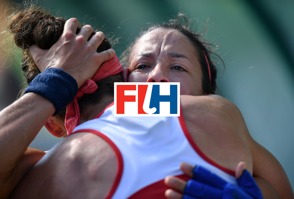 The USA's Melissa Gonzalez (R) cries at the end of the the women's quarterfinal field hockey USA vs Germany match of the Rio 2016 Olympics Games at the Olympic Hockey Centre in Rio de Janeiro on August 15, 2016. / AFP / MANAN VATSYAYANA        (Photo credit should read MANAN VATSYAYANA/AFP/Getty Images)