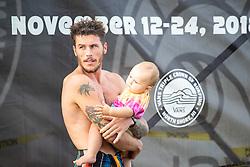 Jack Freestone of Australia and his daughter on Day 3 of the Hawaiian Pro at Haleiwa, Oahu, Hawaii, USA.