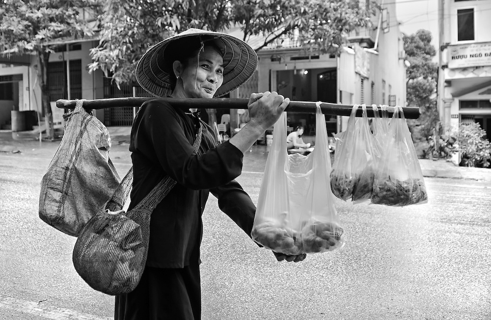 A woman selling her goods in Lao Cai, Vietnam.