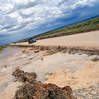 080114  Adron Gardner/Independent<br /> <br /> Water deposits along Historic Highway 66 from heavy monsoon rains near Churchrock Friday.