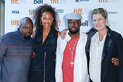 L-R; musician SEDECK JEAN, director MICHELLE MAJOR, musician WYCLEF JEAN, director MAIKEN BAIRD at the 'Venus & Serena' Premiere during the 2012 Toronto International Film Festival at the Ryerson Theatre, September 11th, 2012. Photo by David Tabor/i-Images.
