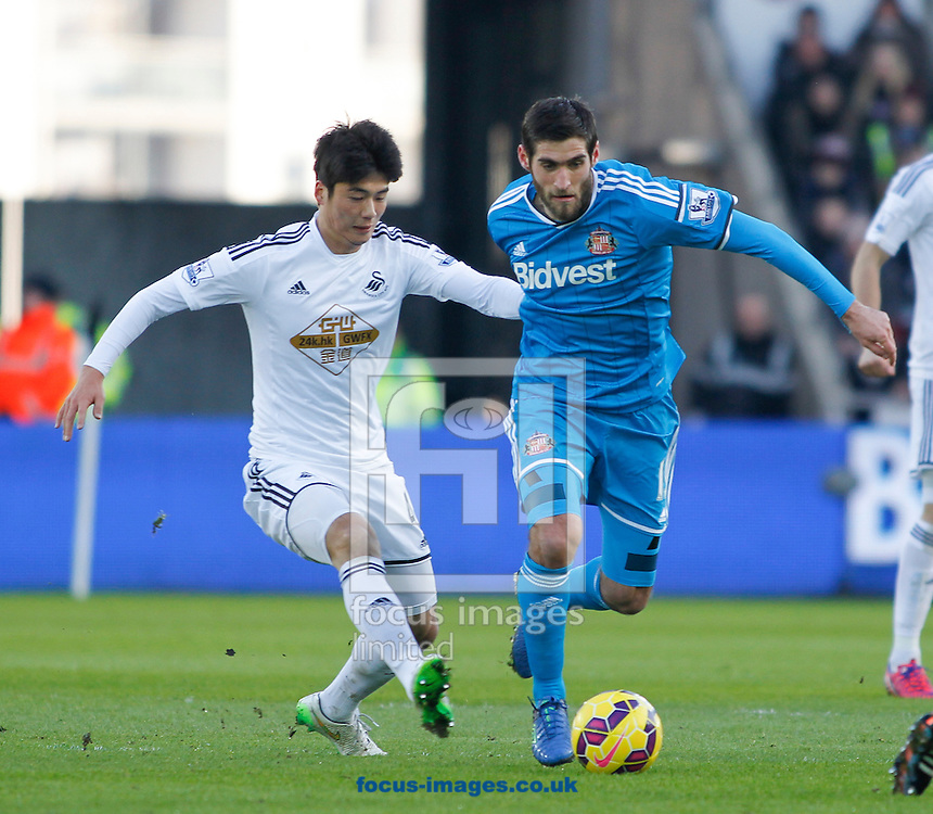 Ki Sung-Yeung of Swansea City and Danny Graham of Sunderland during the Barclays Premier League match at the Liberty Stadium, Swansea<br /> Picture by Mike Griffiths/Focus Images Ltd +44 7766 223933<br /> 07/02/2015