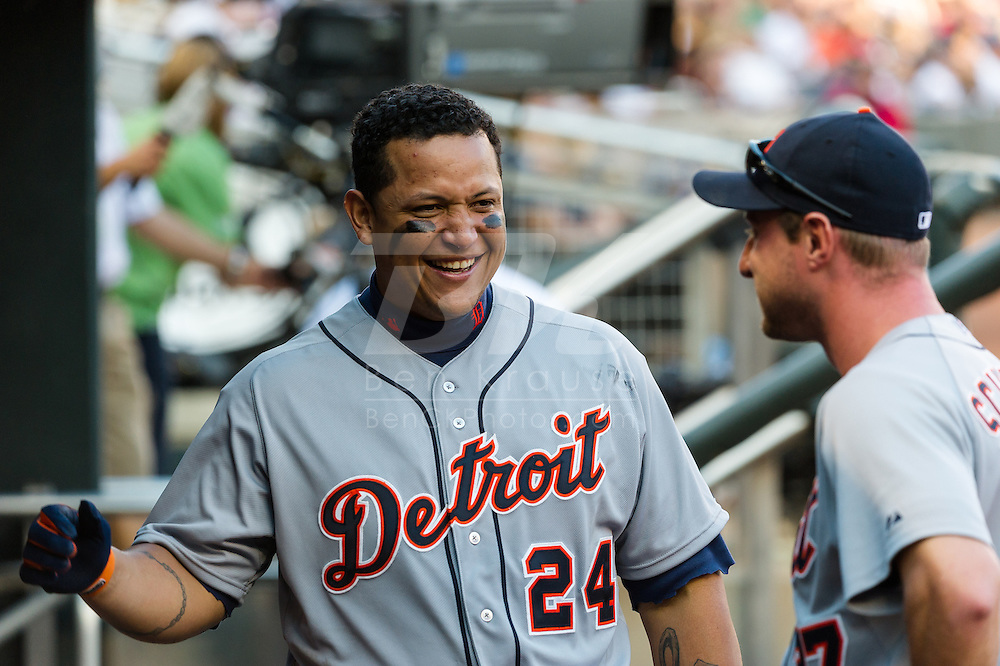 Miguel Cabrera #24 of the Detroit Tigers laughs with teammate Max Scherzer #37 in the dugout during a game against the Minnesota Twins on September 29, 2012 at Target Field in Minneapolis, Minnesota.  The Tigers defeated the Twins 6 to 4.  Photo: Ben Krause