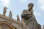 The statue of St. Peter, right, stands at the front of St. Peter's Basilica in Vatican City. St. Peter's Basilica is officially known as Basilica di San Pietro in Vaticano.  In Catholic tradition, St. Peter's Basilica is the burial site of its namesake Saint Peter, who was one of the twelve apostles of Jesus and, according to tradition, was the first Bishop of Antioch, and later first Bishop of Rome and therefore first in the line of the papal succession. (Photo by Phelan M. Ebenhack)