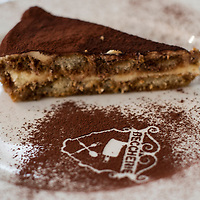 "TREVISO, ITALY - AUGUST 24:  A slice of Tiramisu is seen at the Restaurant ""Alle Beccherie on August 24, 2013 in Treviso, Italy. Treviso claims that Tiramisu was invented in the 1970s by Ada Campoel, the owner of the Restaurant called ÒAlle BeccherieÓ, who supposedly wanted to create a dessert that would give her an energy boost after the birth of her son.  (Photo by Marco Secchi/Getty Images)"