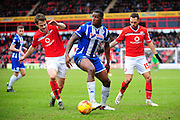 Donervon Daniels of Wigan Athletic under pressure from Andy Taylor of Walsall FC during the Sky Bet League 1 match between Walsall and Wigan Athletic at the Banks's Stadium, Walsall, England on 20 February 2016. Photo by Mike Sheridan.