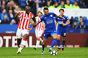 Leicester City midfielder Riyad Mahrez (26) battles with Stoke City defender Bruno Martins Indi (15) during the Premier League match between Leicester City and Stoke City at the King Power Stadium, Leicester, England on 1 April 2017. Photo by Jon Hobley.