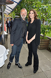 GRAHAM NORTON and NIGELLA LAWSON at an Evening at The River Cafe in aid of the NSPCC held at The River Cafe, Thames Wharf, Rainville Road, London on 19th June 2016