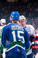 REGINA, SK - MAY 23: Glenn Gawdin #15 of the Swift Current Broncos shakes hands with Nick Henry #21 of the Regina Pats at the Brandt Centre on May 23, 2018 in Regina, Canada. (Photo by Marissa Baecker/CHL Images)