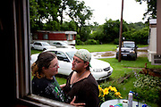 Genesis and Jason share a private moment outside. The family recently received a packet from the Licking County Coalition of Housing with information to possibly aide them in finding a new home before the Dec. 31 mandatory vacate deadline, but with no money for gas or cell phone minutes, prospects of looking for a job and saving up are grim.