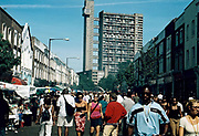 Street scene including Trellick Tower Notting Hill Carnival London UK 2001