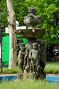 A water fountain with figures of children in Bucharest, Romania
