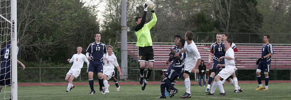 One of the many close calls for Liberty goalie Blake Weiss as the Fauquier Falcons  blast through the net to beat the Eagles 4-2 at Fauquier High School in Warrenton on Apr. 9th.--Times Photo/Greg Nash