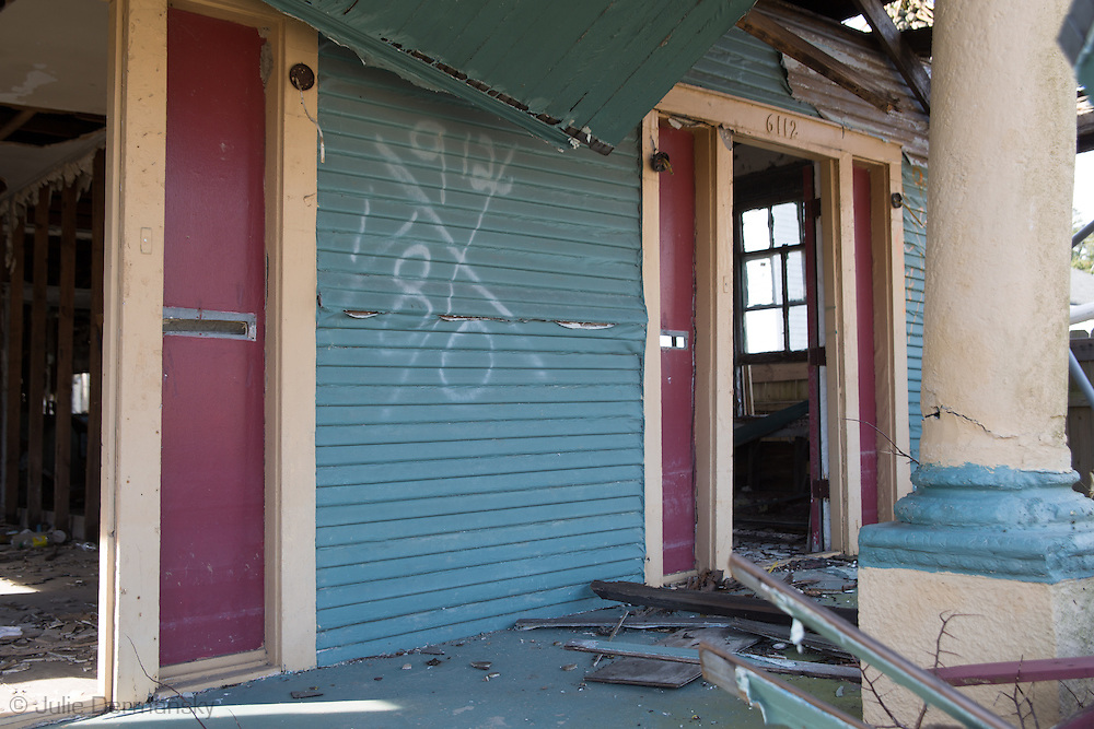"""Home in New Orleans lower 9th Ward with a  Katrina tattoo, a """"X"""" code, spray-painted by search-and-rescue teams on homes after hurricane Katrina.Nine years after hurricane Katrina parts of the city have still not recovered."""