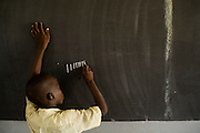 Boy counting on the black board during math class at the Essaout primary school in the village of Essaout, Senegal, on Thursday June 14, 2007...