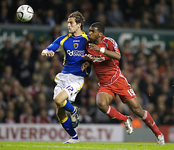 LIVERPOOL, ENGLAND - Wednesday, October 31, 2007: Liverpool's Ryan Babel and Cardiff City's Roger Johnson during the League Cup 4th Round match at Anfield. (Photo by David Rawcliffe/Propaganda)