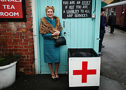 © Licensed to London News Pictures. <br /> 16/10/2016. <br /> Grosmont, UK.  <br /> <br /> A woman in 1940's period clothing stands on the platform at Grosmont station during the final day of the North Yorkshire Moors Railway Wartime Weekend event. <br /> The annual event brings together re-enactors and enthusiasts along the length of the NYMR heritage steam railway line to recreate the feel of the war years of the 1940's. <br /> <br /> Photo credit: Ian Forsyth/LNP