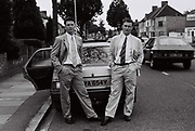 The Clements Brothers posing by car, Southall, UK, 1986.