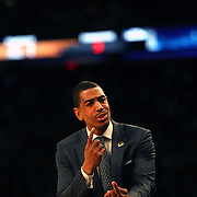 Kevin Ollie, Head Coach of UConn, in action on the sideline during the Iowa State Cyclones Vs Connecticut Huskies basketball game during the 2014 NCAA Division 1 Men's Basketball Championship, East Regional at Madison Square Garden, New York, USA. 28th March 2014. Photo Tim Clayton