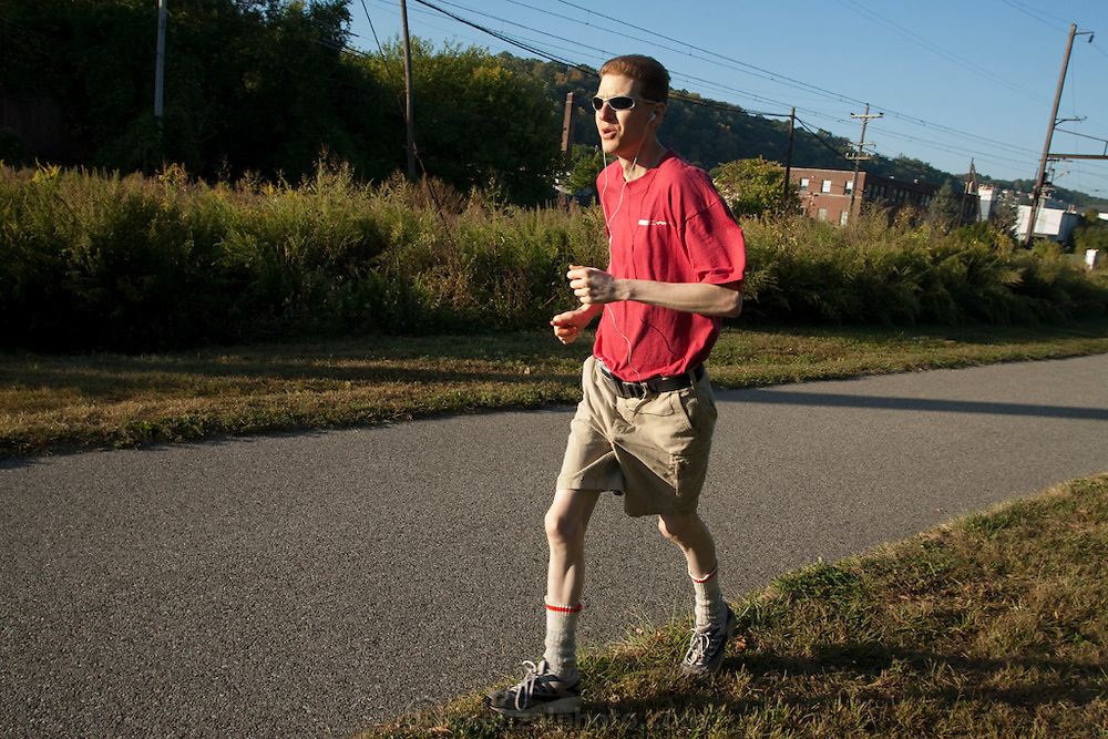 "Michael Rae, on a weekday morning run near his suburban Philadelphia home (From the book What I Eat: Around the World in 80 Diets.) The caloric value of his day's worth of food in July was fixed at 1,900 kcals. He is 32; 5'11,5"" and 114 pounds. Michael is research assistant to the theoretician and biomedical gerontologist Aubrey de Grey, and they are the coauthors of the book Ending Aging."