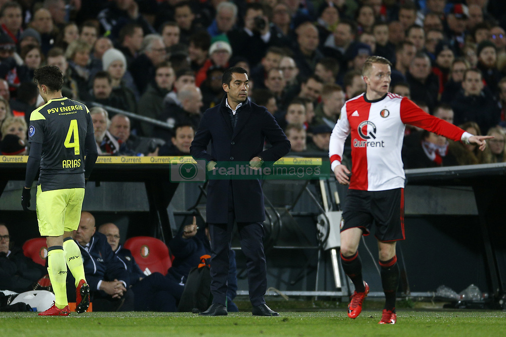 Coach Giovanni van Bronckhorst of Feyenoord (C) during the Dutch KNVB quarter final match between Feyenoord Rotterdam and PSV Eindhoven at the Kuip on January 31, 2018 in Rotterdam, The Netherlands
