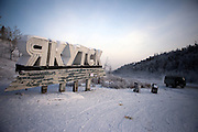 Entrance to the area of the city of Yakutsk. Yakutsk (Russian: ???????) is a city in the Russian Far East, located about 4° (450 kilometres) south of the Arctic Circle. It is the capital of the Sakha (Yakutia) Republic in Russia with a major port on the Lena River. The city has a population of 264.000 (2009). Yakutsk is one of the coldest cities on Earth. The average monthly winter temperature in January is around -43,2 °C. Yakutsk, Jakutsk, Yakutia, Russian Federation, Russia, RUS, 23.01.2010.