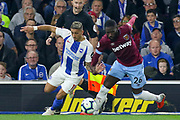 Brighton and Hove Albion midfielder Anthony Knockaert (11) battles with West Ham United defender Arthur Masuaku (26) during the Premier League match between Brighton and Hove Albion and West Ham United at the American Express Community Stadium, Brighton and Hove, England on 5 October 2018.