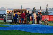 Hot air balloon crew preparing for an early morning launch, Crown of Maine Balloon Fair, Presque Isle, Maine.