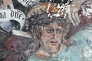 Detail of Christ's head wearing the crown of thorns, from Christ carrying the Cross, meeting Veronica with her cloth and a kneeling donor, mural painting, 1561, restored 1902, in the Collegiate Church of Saint-Gervais-Saint-Protais, built 12th to 16th centuries in Gothic and Renaissance styles, in Gisors, Eure, Haute-Normandie, France. The church was consecrated in 1119 by Calixtus II but the nave was rebuilt from 1160 after a fire. The church was listed as a historic monument in 1840. Picture by Manuel Cohen